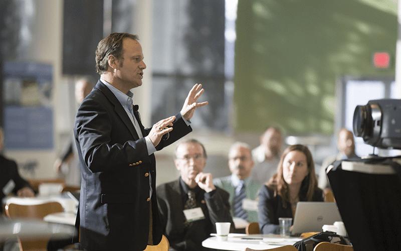 man leading a tech talk